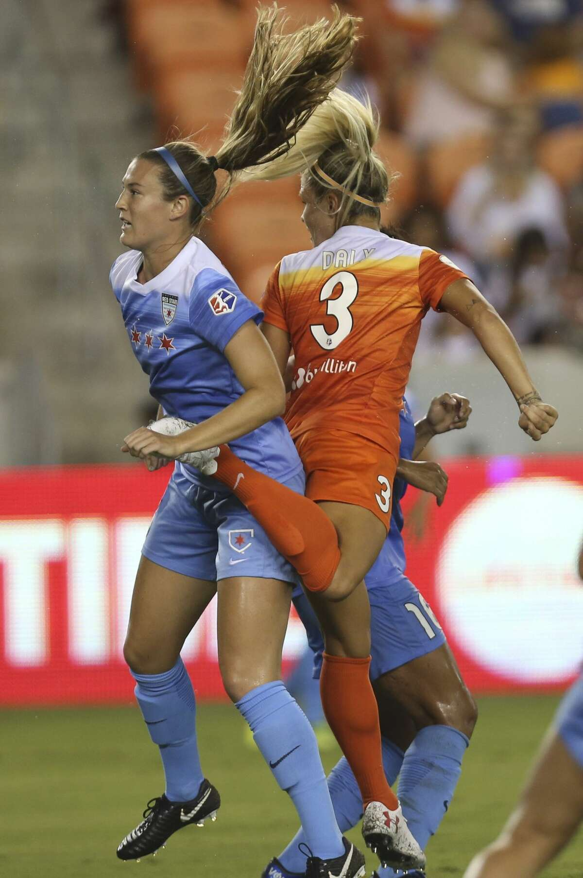 Houston Dash forward Rachel Daly (3) tries to score with the back of her foot while Chicago Red Stars defender Katie Naughton (5) is defensing her during the first half of the game at BBVA Compass Stadium Saturday, Sept. 23, 2017, in Houston. ( Yi-Chin Lee / Houston Chronicle )