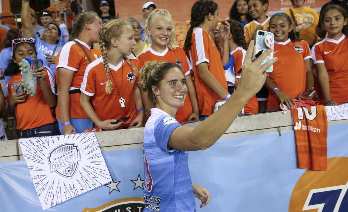 Former Houston Dash player and current Chicago Red Stars player Morgan Brian takes a selfie with fans after the last home game at BBVA Compass Stadium Saturday, Sept. 23, 2017, in Houston. ( Yi-Chin Lee / Houston Chronicle )