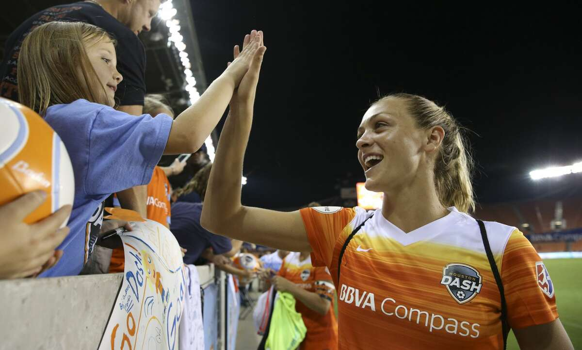Houston Dash midfielder Cami Privett (23) high-fives a young fan after the last home game at BBVA Compass Stadium Saturday, Sept. 23, 2017, in Houston. ( Yi-Chin Lee / Houston Chronicle )