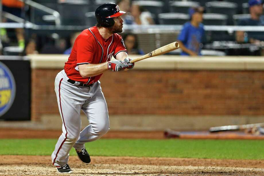 Washington Nationals' Daniel Murphy watches his solo home run during the 10th inning of a baseball game against the New York Mets on Saturday, Sept. 23, 2017, in New York. (AP Photo/Adam Hunger) ORG XMIT: NYM119 Photo: Adam Hunger / FR110666 AP