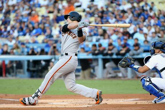 LOS ANGELES, CA - SEPTEMBER 23:  Buster Posey #28 of the San Francisco Giants hits an RBI single in the first inning against the Los Angeles Dodgers at Dodger Stadium on September 23, 2017 in Los Angeles, California.  (Photo by Stephen Dunn/Getty Images)