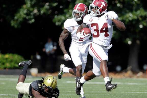 Alabama running back Damien Harris racked up 151 rushing yards and three scores in a 59-0 Crimson Tide win.
