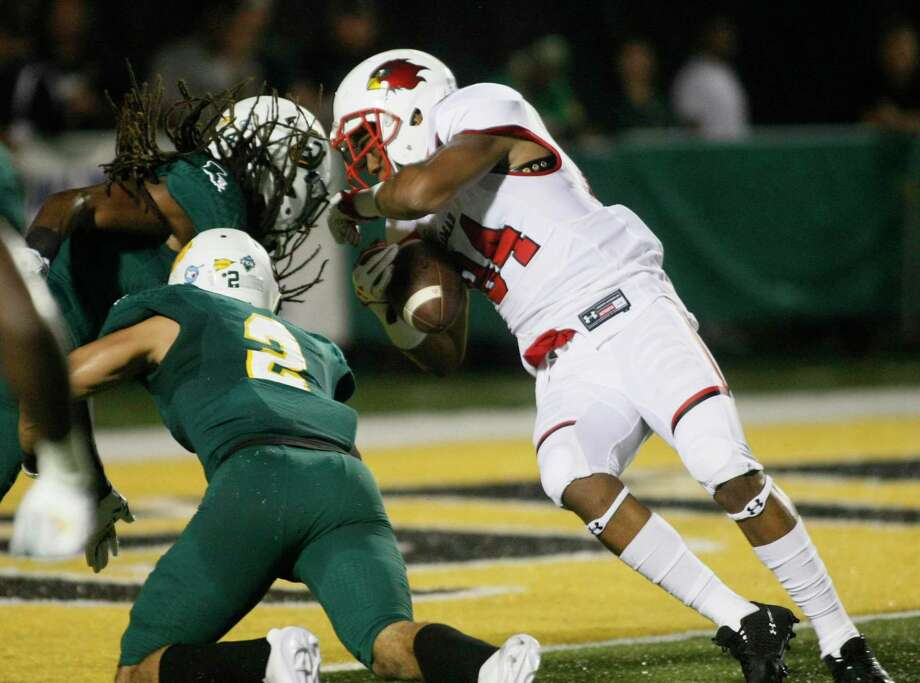 Lamar University's junior wide receiver Isaiah Howard, right, in a touchdown play against Southeastern Louisiana defenders Mayori Ellison and Ryan Sigers in Hammond, Louisiana, on Saturday, Sept. 23, 2017. Randolph Bergeron, Southeastern Louisiana Athletics Photo: Randolph Bergeron, Randolph Bergeron, Southeastern