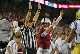 PALO ALTO, CA - SEPTEMBER 23:  K.J. Costello #3 of the Stanford Cardinal signals touchdown with the official after scoring on a nine yard touchdown run against the UCLA Bruins in the second quarter of their NCAA football game at Stanford Stadium on September 23, 2017 in Palo Alto, California.  (Photo by Thearon W. Henderson/Getty Images)
