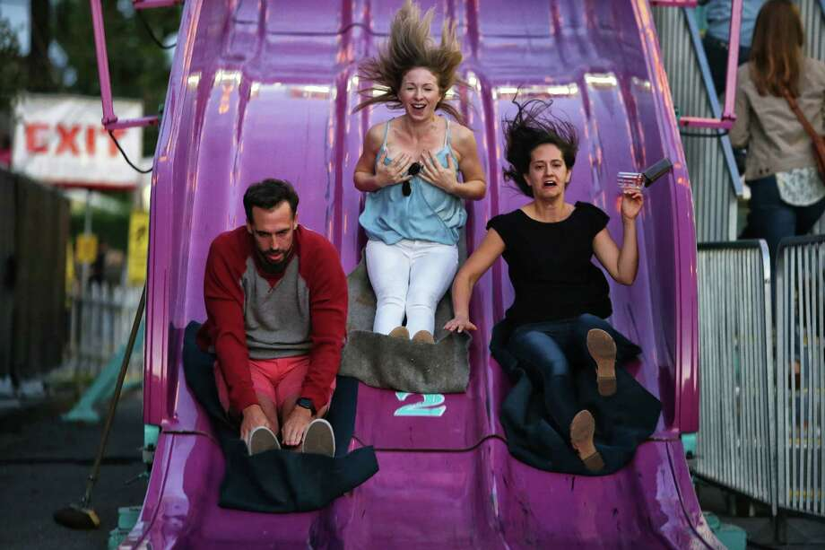 Dan Deaver, left, Kelsey Calabro, center, and Maja Ivanovic go down the Alpine Slide during the annual Fremont Oktoberfest, Saturday, Sept 23, 2017. Photo: GENNA MARTIN,  SEATTLEPI / SEATTLEPI.COM