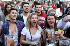 People cheer as contestants try to hold up a full stein for as long as they can during the annual Fremont Oktoberfest, Saturday, Sept 23, 2017.