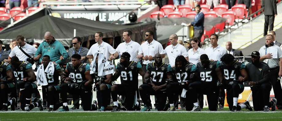 LONDON, ENGLAND - SEPTEMBER 24:  Jacksonville Jaguar players show their protest during the National Anthem during the NFL International Series match between Baltimore Ravens and Jacksonville Jaguars at Wembley Stadium on September 24, 2017 in London, England.Browse through the photos to see the rest of the Jags, Ravens protest Sunday morning.  Photo: Matthew Lewis, Getty Images / 2017 Getty Images