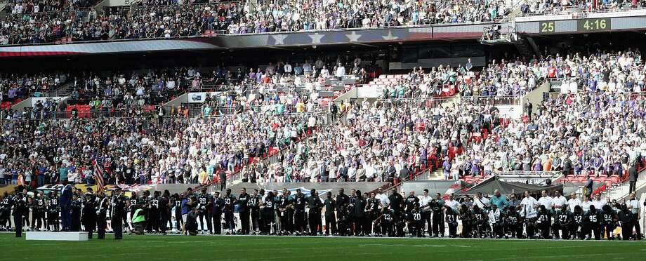 Jacksonville Jaguar players show their protest during the National Anthem during the NFL International Series match between Baltimore Ravens and Jacksonville Jaguars at Wembley Stadium on September 24, 2017 in London, England. Photo: Matthew Lewis, Getty Images / 2017 Getty Images