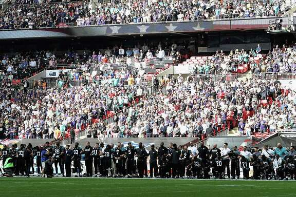 LONDON, ENGLAND - SEPTEMBER 24:  Jacksonville Jaguar players show their protest during the National Anthem during the NFL International Series match between Baltimore Ravens and Jacksonville Jaguars at Wembley Stadium on September 24, 2017 in London, England.