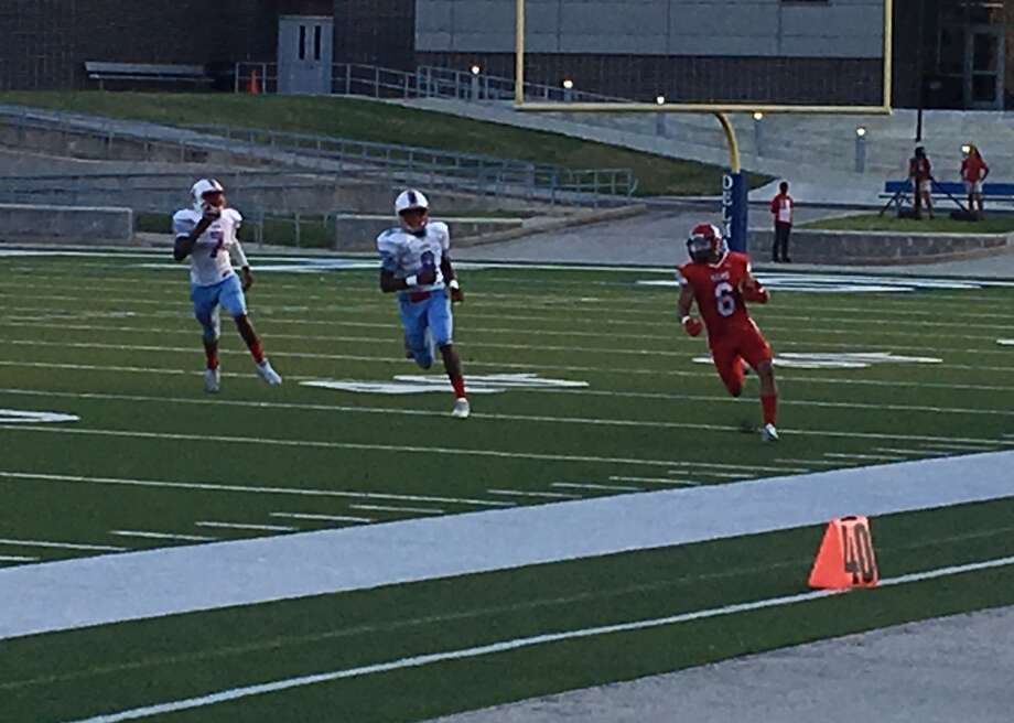 Waltrip receiver Samuel Lemond eludes the pursuit of Madison defenders Charlie Jones and Darian Jackson during a long gain Sept. 23 at Delmar Stadium. Lemond finished with 144 yards and a touchdown as Waltrip won 20-0. Photo: Jack Marrion