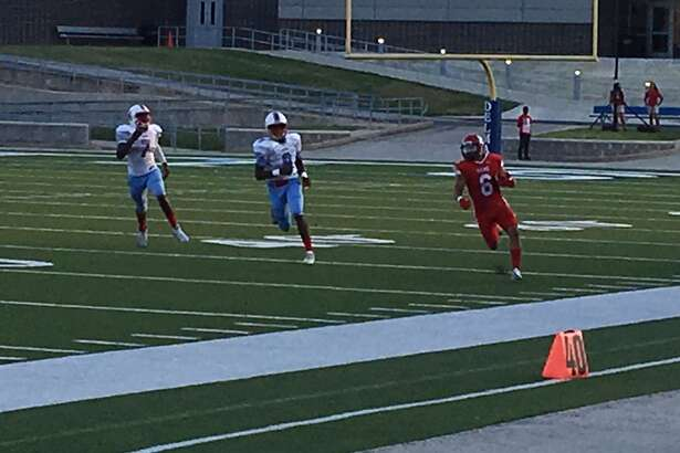 Waltrip receiver Samuel Lemond eludes the pursuit of Madison defenders Charlie Jones and Darian Jackson during a long gain Sept. 23 at Delmar Stadium. Lemond finished with 144 yards and a touchdown as Waltrip won 20-0.