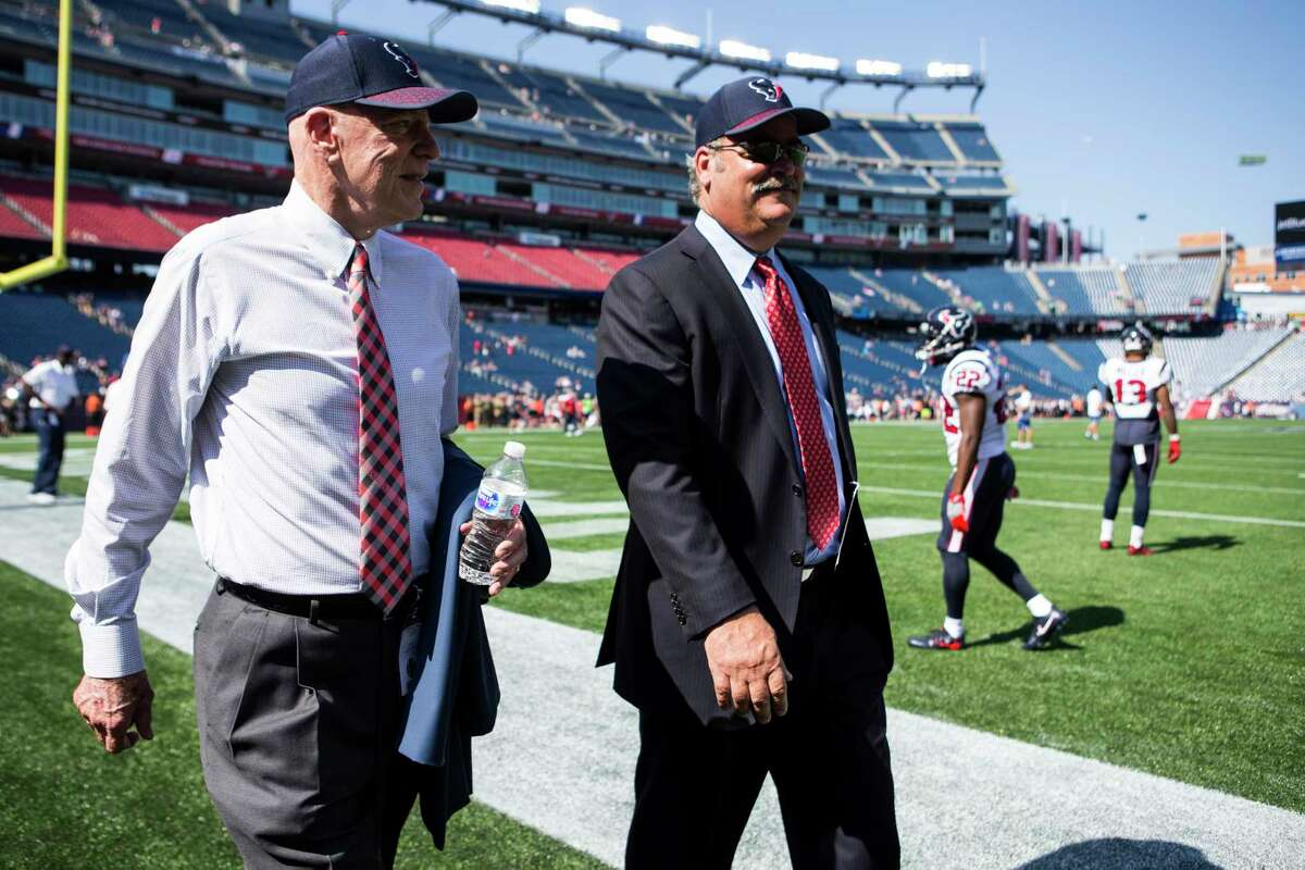 Houston Texans owner Bob McNair and Cal McNair, Texans COO, walk off the field before Texans NFL football game againt the New England Patriots at Gillette Stadium on Sunday, Sept. 24, 2017, in Foxbourough, Mass.