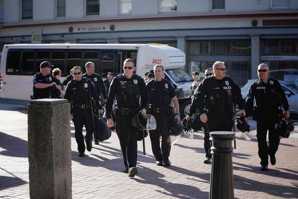 Police officers arrive at Sproul Plaza in Berkeley, Calif., on Sunday, September 24th, 2017.