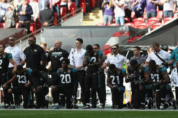 LONDON, ENGLAND - SEPTEMBER 24:  Jacksonville Jaguar players show their protest during the National Anthem during the NFL International Series match between Baltimore Ravens and Jacksonville Jaguars at Wembley Stadium on September 24, 2017 in London, England.  (Photo by Matthew Lewis/Getty Images)