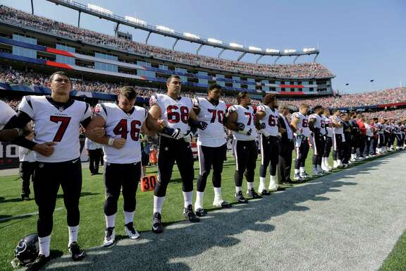 Members of the Houston Texans team stand with arms locked during the national anthem before an NFL football game against the New England Patriots, Sunday, Sept. 24, 2017, in Foxborough, Mass. (AP Photo/Steven Senne)