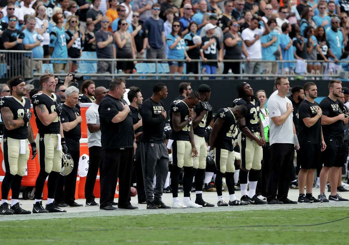CHARLOTTE, NC - SEPTEMBER 24: The New Orleans Saints stand during the National Anthem before their game against the Carolina Panthers at Bank of America Stadium on September 24, 2017 in Charlotte, North Carolina.