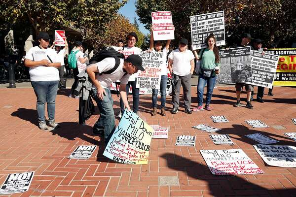 Members of BAMN and other ant-fascism groups protest against Milo Yiannopoulos near Sproul Plaza on the campus of the University of California at Berkeley in Berkeley, Calif., on Sunday, September 24, 2017.