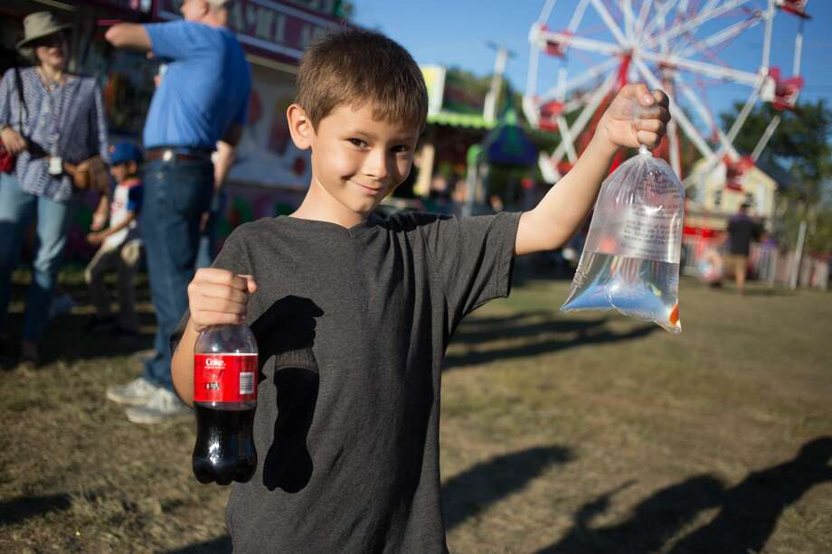 Crowds enjoyed summer-like conditions Saturday during the 98th annual Durham Fair, having fun at the midway rides and games, trying out food of all sorts, visiting the Discovery Tent, listening to live music and checking out the various livestock barns at the fairgrounds. Photo: Alex Syphers Photo