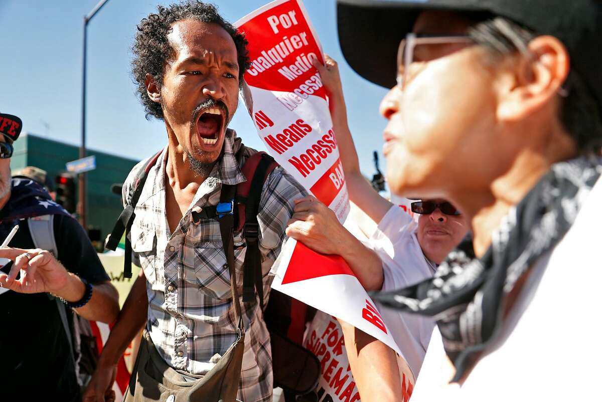 Andrew Durant (left) yells at BAMN's Yvette Felarca during a protest near Sproul Plaza on the campus of the University of California at Berkeley in Berkeley, Calif., on Sunday, September 24, 2017.