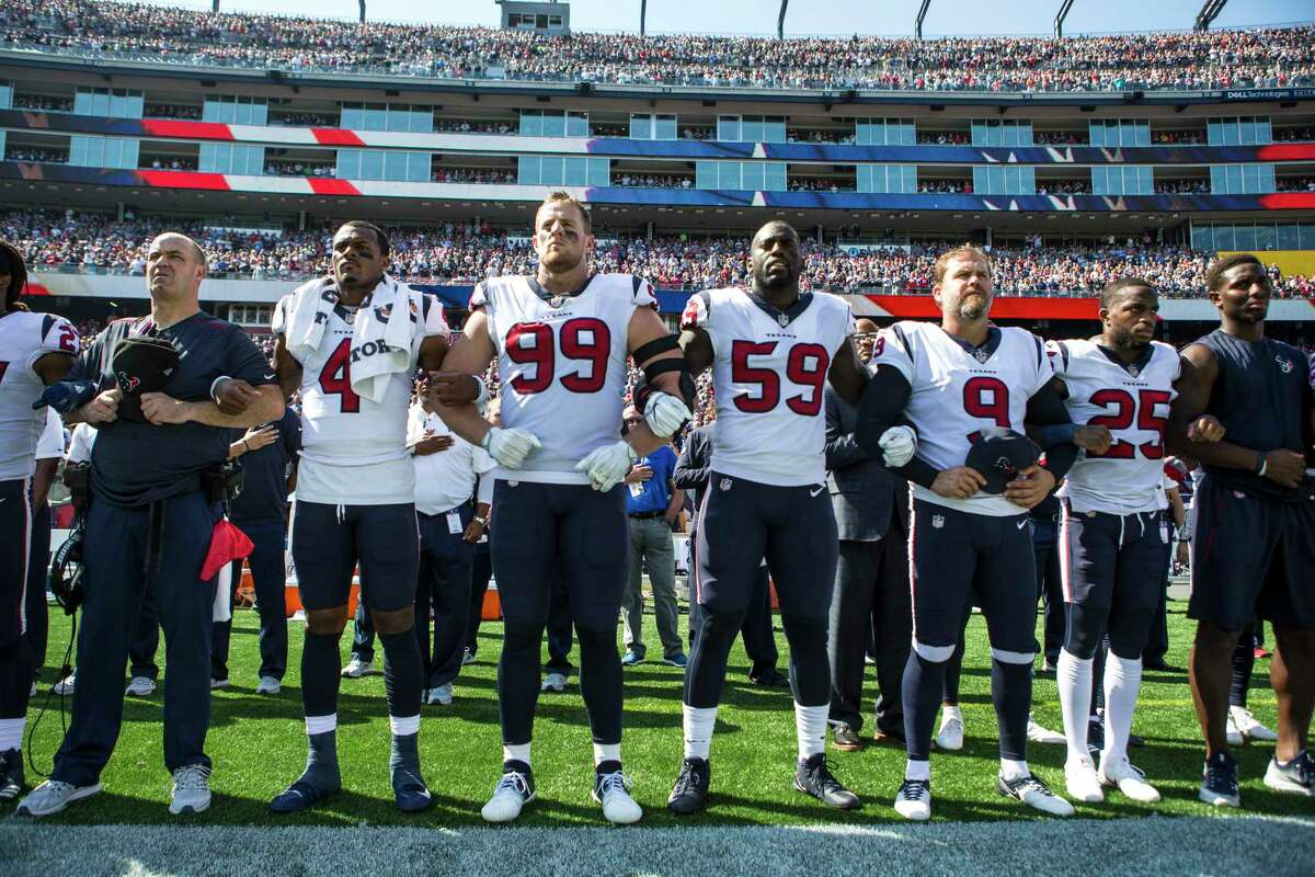 Houston Texans head coach Bill O'Brien lines up with his playes as they lock arm together dring the national anthem before an NFL football game against the New England Patriots at Gillette Stadium on Sunday, Sept. 24, 2017, in Foxbourough, Mass.