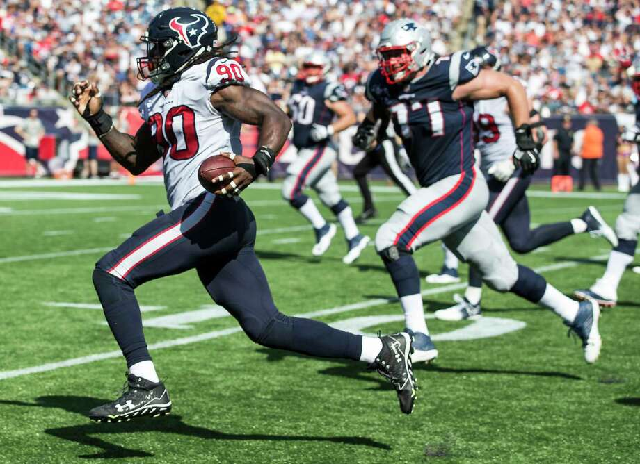 Houston Texans outside linebacker Jadeveon Clowney (90) runs past New England Patriots offensive tackle Nate Solder (77) as he returns a Tom Brady fumble 22 yard for a touchdown during the second quarter of an NFL football game at Gillette Stadium on Sunday, Sept. 24, 2017, in Foxbourough, Mass. Photo: Brett Coomer, Houston Chronicle / © 2017 Houston Chronicle