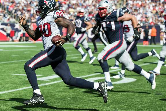 Houston Texans outside linebacker Jadeveon Clowney (90) runs past New England Patriots offensive tackle Nate Solder (77) as he returns a Tom Brady fumble 22 yard for a touchdown during the second quarter of an NFL football game at Gillette Stadium on Sunday, Sept. 24, 2017, in Foxbourough, Mass.