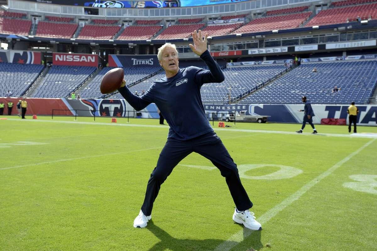 Seattle Seahawks head coach Pete Carroll throws a ball before an NFL football game against the Tennessee Titans Sunday, Sept. 24, 2017, in Nashville, Tenn. (AP Photo/Mark Zaleski)