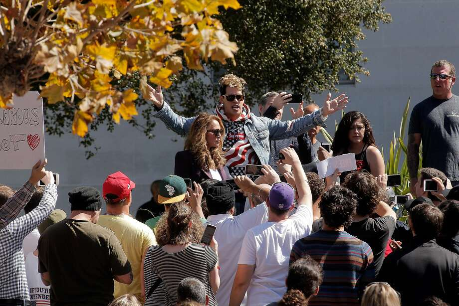Milo Yiannopoulos speaks to a few dozen supporters on the steps of Sprout Hall at University of California Berkeley in Berkeley, Calif., on Sunday, September 24, 2017. The small showing of conservative supporters were dwarfed by the hundreds of protesters kept outside the speaking area. Photo: Carlos Avila Gonzalez, The Chronicle