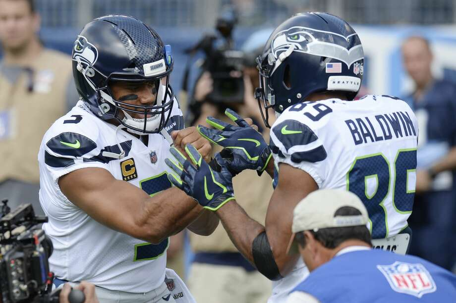 Seattle Seahawks quarterback Russell Wilson (3) and wide receiver Doug Baldwin (89) warm up before an NFL football game against the Tennessee Titans Sunday, Sept. 24, 2017, in Nashville, Tenn. (AP Photo/Mark Zaleski) Photo: Mark Zaleski/AP