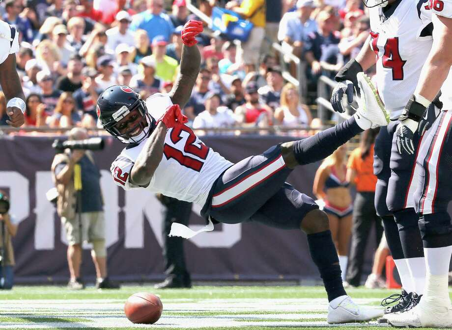 PHOTOS: Bruce Ellington celebrates his first touchdown with the TexansFOXBORO, MA - SEPTEMBER 24:  Bruce Ellington #12 of the Houston Texans reacts after catching a touchdown pass during the first quarter of a game against the New England Patriots at Gillette Stadium on September 24, 2017 in Foxboro, Massachusetts. Photo: Jim Rogash, Getty Images / 2017 Getty Images