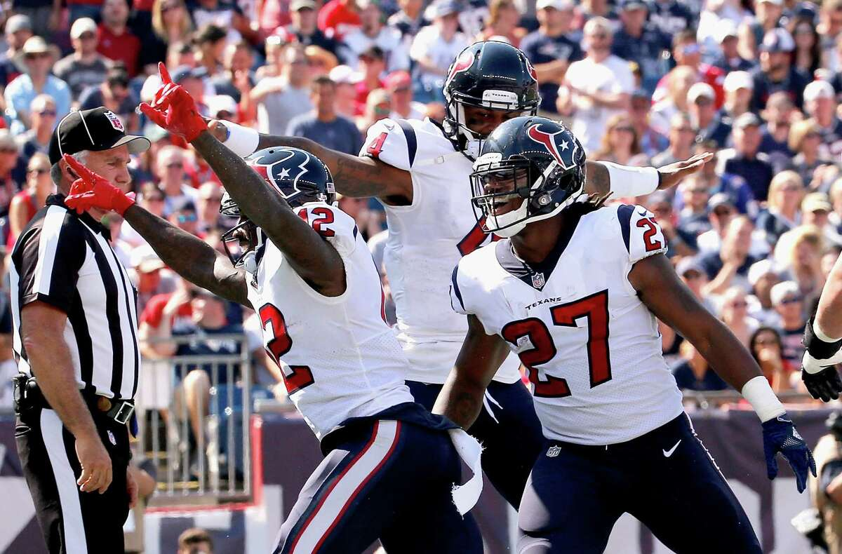 FOXBORO, MA - SEPTEMBER 24: Bruce Ellington #12 of the Houston Texans reacts with Deshaun Watson #4 and D'Onta Foreman #27 after catching a touchdown pass during the first quarter of a game against the New England Patriots at Gillette Stadium on September 24, 2017 in Foxboro, Massachusetts.