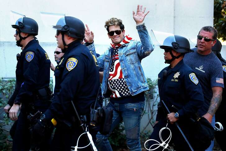 Milo Yiannopoulos leaves Sproul Plaza after a short appearance on the campus of the University of California at Berkeley in Berkeley, Calif., on Sunday, September 24, 2017.