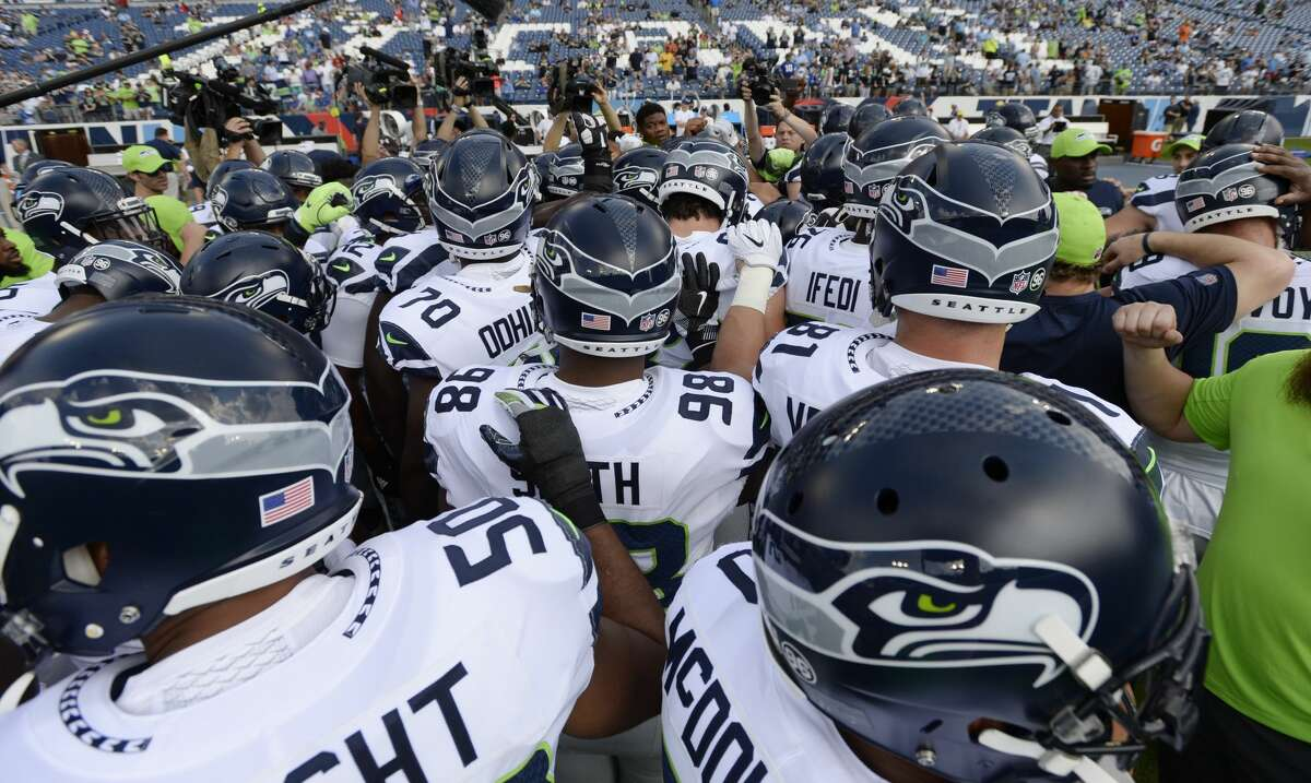 Seattle Seahawks players gather before an NFL football game against the Tennessee Titans Sunday, Sept. 24, 2017, in Nashville, Tenn. (AP Photo/Mark Zaleski)