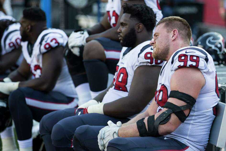 Houston Texans defensive end J.J. Watt (99) and nose tackle D.J. Reader (98) sit on the bench after the Texans gave up a last-second touchdown to the New England Patriots during the fourth quarter of an NFL football game at Gillette Stadium on Sunday, Sept. 24, 2017, in Foxbourough, Mass. The Patriots beat the Texans 36-33.