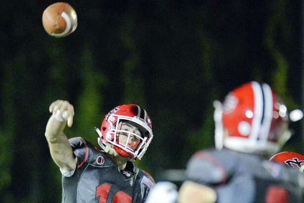 New Canaan quarterback Drew Pyne throws to receiver Griffin Arnone in a FCIAC varsity football game against Trumbull in New Canaan, Connecticut on Friday, Sept. 22, 2017. New Canaan defeated Trumbull 61-14.