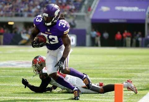 ef15654b994 Minnesota Vikings running back Dalvin Cook (33) runs from Tampa Bay  Buccaneers cornerback Vernon