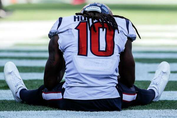 Houston Texans wide receiver DeAndre Hopkins (10) sits on the field after a last-second pass to the end zone failed, giving the New England Patriots a 36-33 win at Gillette Stadium on Sunday, Sept. 24, 2017, in Foxbourough, Mass.