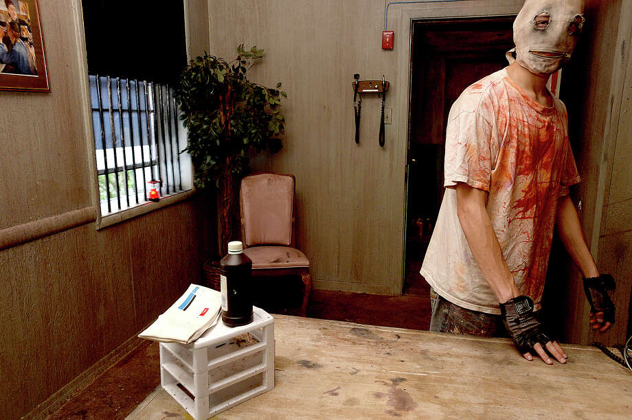 Actors portraying workers and residents of the new Rose Hill Asylum addition await thrill seekers at the Haunted Hotel in Beaumont. The second floor addition has been two years in the making and offers a new layer of creepy to the popular downtown Halloween venue. Some rooms in the first floor have been revamped, as well, and sensory additions like scented fog will add to the overall experience.  The Haunted Hotel tours opened Friday and will run Friday and Saturday, 7 pm - midnight, and Sunday, 7 - 10 pm.  Escape room bookings are also running Wednesday and Friday through Sunday 11 am to 5 pm.  Entry fees for both events are $24 per person, with $5 off if you bring a can, empty or full, of any Pepsi product, which is one of the venue's sponsors. The offer is valid for cans only.  Photo taken Saturday, September 23, 2017 Kim Brent/The Enterprise Photo: Kim Brent / BEN