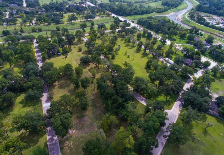 Much of the Arbor Oaks neighborhood in northwest Houston sits empty. All but 13 of the original 160 homes were sold to the flood district after previous flooding. (Mark Mulligan / Houston Chronicle)