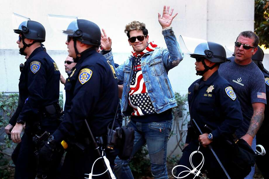Milo Yiannopoulos leaves Sproul Plaza after a brief UC Berkeley appearance that sparked protests on Sunday. Photo: Scott Strazzante, The Chronicle
