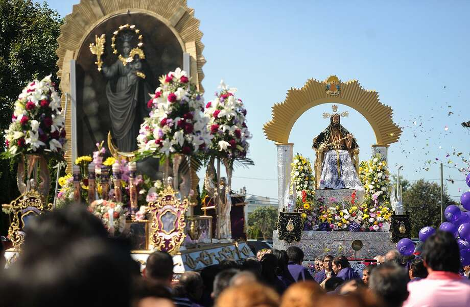 Litters covered in religious icons, flowers, and images of Christ are carried slowly on to Pembroke Street outside Saint Mary Roman Catholic Church in Bridgeport, Conn. for the annual Procesion del Senor de los Milagros, also called Lord of Miracles, on Sunday, September 24, 2017. The procession, held for the second straight year in the city, is an important Peruvian and Latin American tradition which dates back to a Peruvian earthquake in 1655. A church wall containing an image of Christ was spared damage, which was declared a miracle. Photo: Brian A. Pounds / Hearst Connecticut Media / Connecticut Post