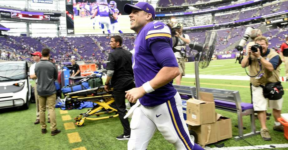 MINNEAPOLIS, MN - SEPTEMBER 24: Case Keenum #7 of the Minnesota Vikings smiles as he jogs off the field after the game against the Tampa Bay Buccaneers on September 24, 2017 at U.S. Bank Stadium in Minneapolis, Minnesota. The Vikings defeated the Buccaneers 34-17. (Photo by Hannah Foslien/Getty Images) Photo: Hannah Foslien/Getty Images