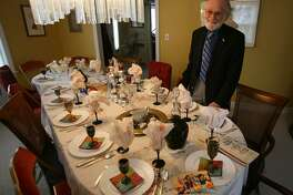 Rabbi Israel C. Stein with his table set for Seder at his home in Fairfield on Monday, April 18, 2011. Stein, Rabbi Emeritus at Congregation Rodeph Sholom in Bridgeport, died Saturday, Sept. 23, 2017.