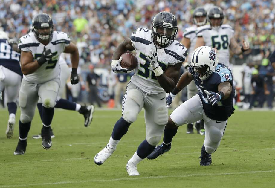 Seattle Seahawks running back Chris Carson (32) gets past Tennessee Titans inside linebacker Avery Williamson (54) as Carson scores a touchdown on a 10-yard run in the second half of an NFL football game Sunday, Sept. 24, 2017, in Nashville, Tenn. (AP Photo/James Kenney) Photo: James Kenney/AP