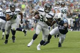 Seattle Seahawks running back Chris Carson (32) gets past Tennessee Titans inside linebacker Avery Williamson (54) as Carson scores a touchdown on a 10-yard run in the second half of an NFL football game Sunday, Sept. 24, 2017, in Nashville, Tenn. (AP Photo/James Kenney)