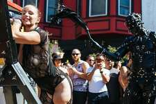 Bella Rossi is flogged by Jason Basciano during the Folsom Street Fair in San Francisco, Calif. Sunday, September 24, 2017.