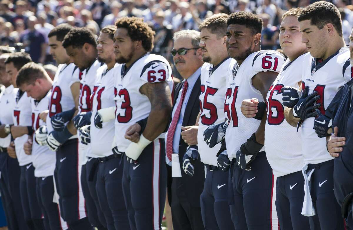 Houston Texans players lock arms during the national anthem before the Texans NFL football game against the New England Patriots at Gillette Stadium on Sunday, Sept. 24, 2017, in Foxbourough, Mass. ( Brett Coomer / Houston Chronicle )