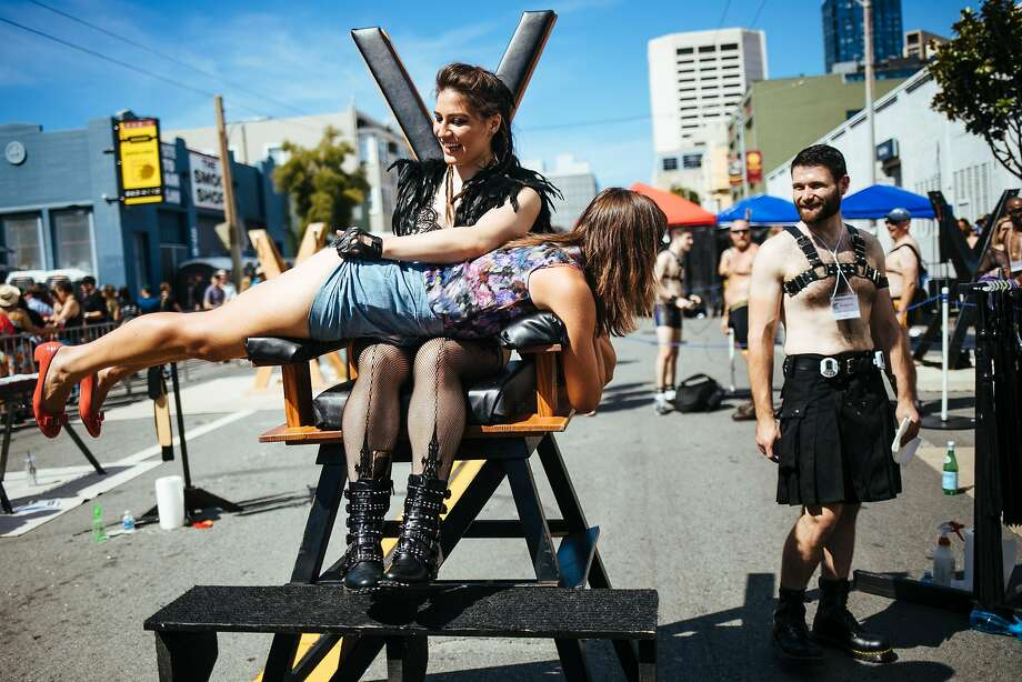 A women is spanked at Folsom Street Fair in San Francisco, Calif. Sunday, September 24, 2017. Photo: Mason Trinca, Special To The Chronicle