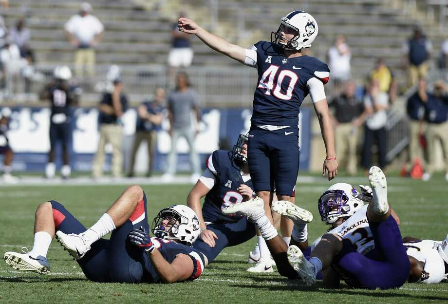 UConn kicker Michael Tarbutt (40) watches his 35-yard field goal attempt miss wide right in the closing seconds against East Carolina on Sunday. Photo: Jessica Hill / Associated Press / AP2017