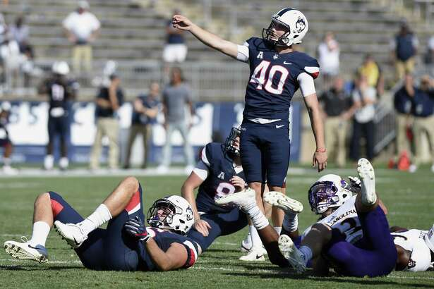 UConn kicker Michael Tarbutt (40) watches his 35-yard field goal attempt miss wide right in the closing seconds against East Carolina on Sunday.